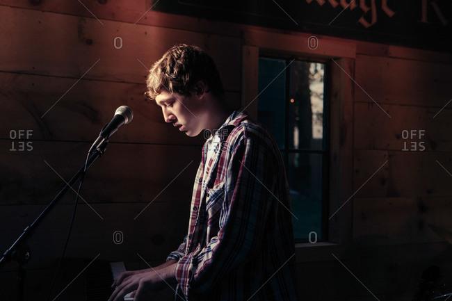 Teen at a keyboard playing
