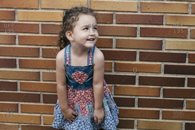 Portrait of smiling little girl wearing patterned summer dress