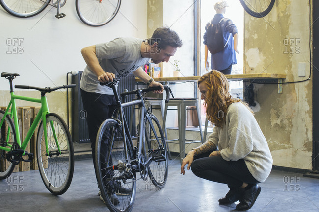 Salesman advising client in a custom-made bicycle store