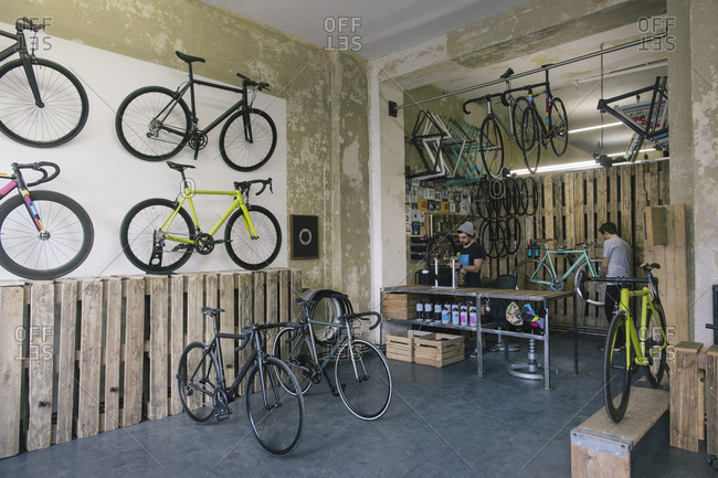 Mechanics working in a custom-made bicycle store