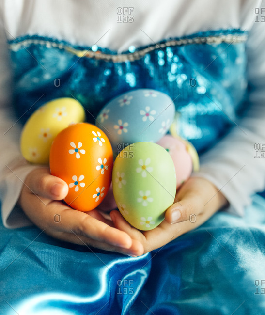 Little girl's hands holding Easter eggs