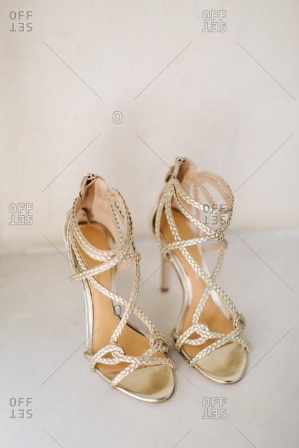 Close up of gold high heels