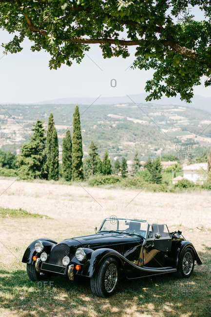Provence, France - July 4, 2015: Pristine classic car parked in the country
