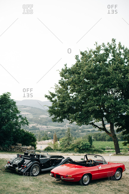 Provence, France - July 4, 2015: Two classic car parked on a hill in the country