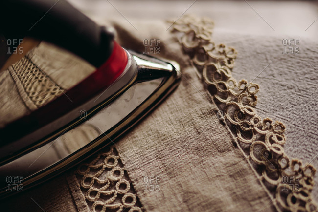 Close-up of iron and vintage linens