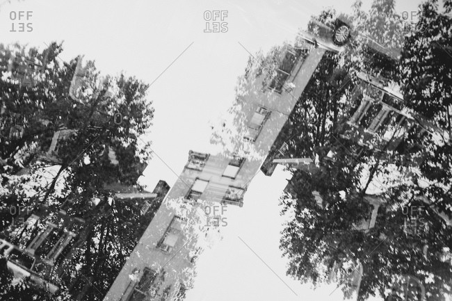 Double exposure of buildings and trees