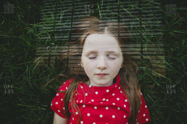 Double exposure of a girl and grass