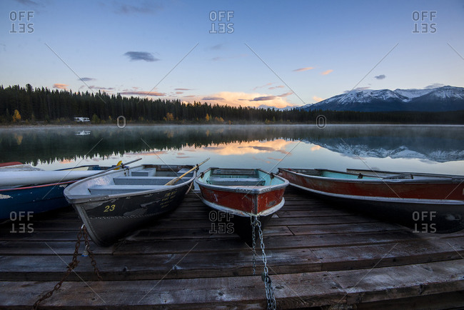Boats chained to a dock on a mountain lake
