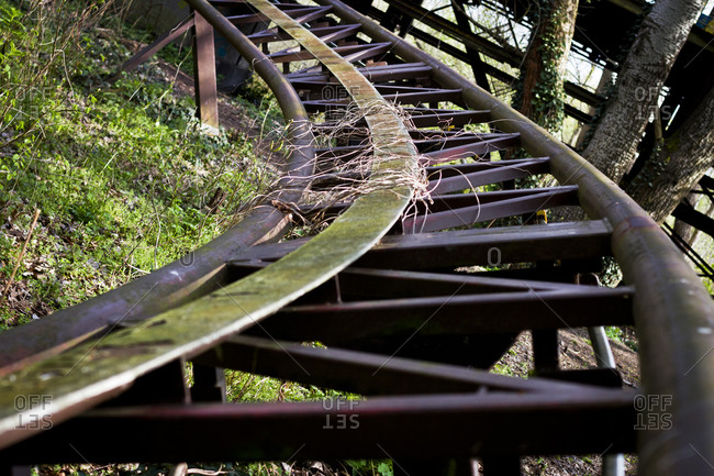 Overgrown rollercoaster rails in the abandoned Spreepark in Berlin, Germany