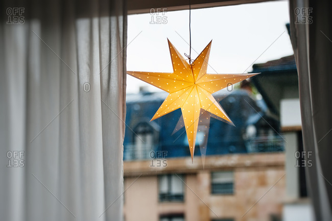 Christmas Scandinavian star lantern hanging in a window