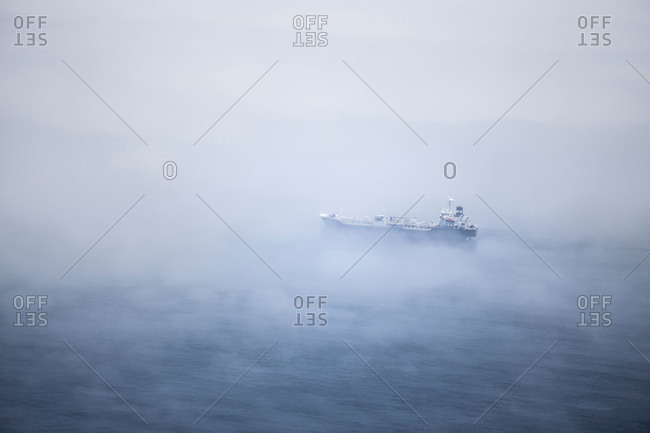 Freight ship in the fog
