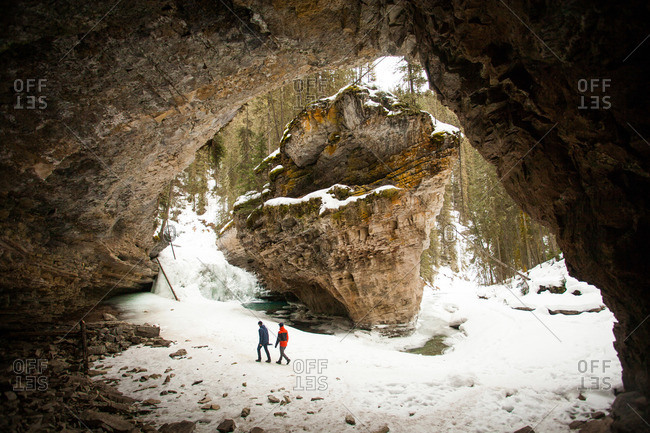 People exploring winter rock formations