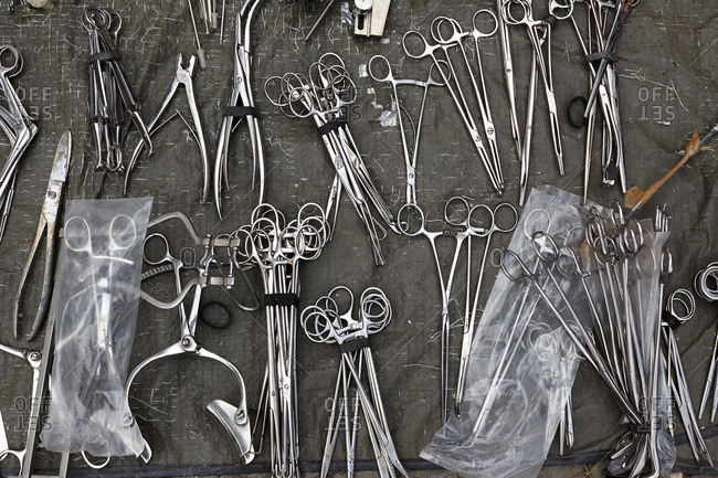 Various scissors and surgical equipment on a green cloth