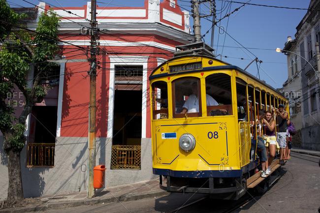 Rio de Janeiro, Brazil - September 18, 2010: Tourists ride the historic Santa Teresa Tram in the hills of Rio de Janeiro