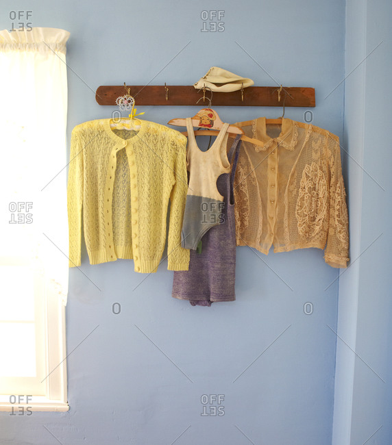 Clothes hanging on hooks in a room