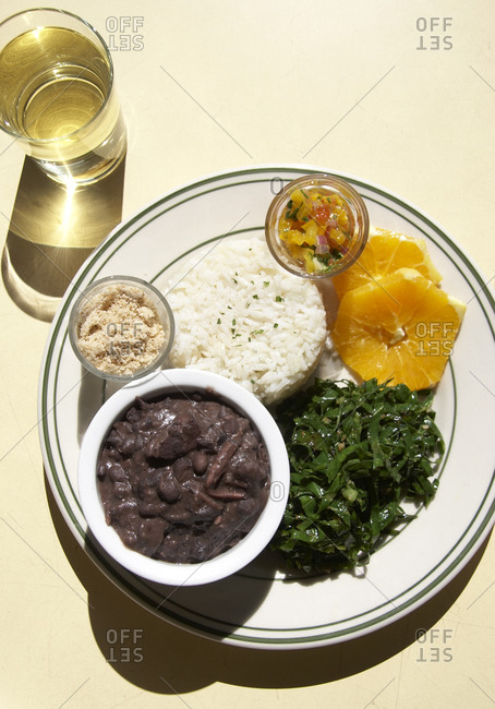 Cuban food on a plate with a drink