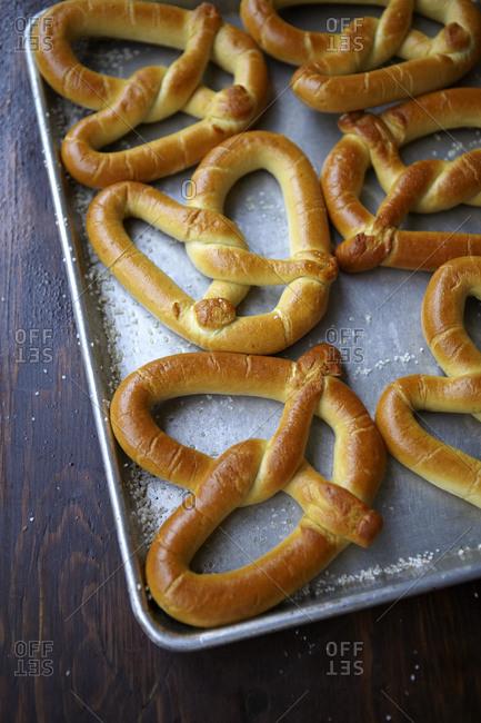 Soft pretzels on a baking sheet