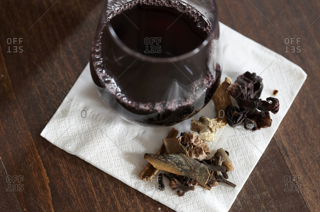 Glass of red wine with spices