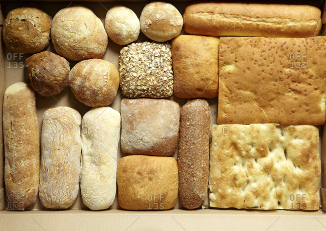 Overhead view of bread varieties in a box