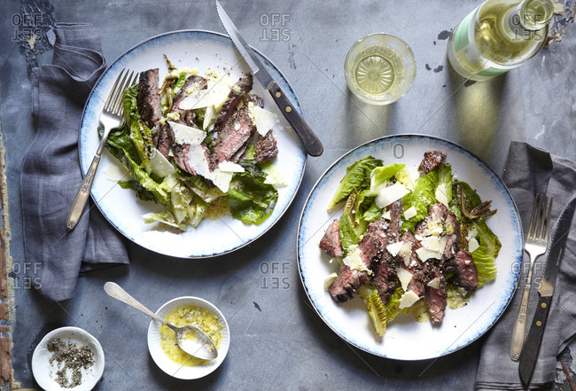 Steak and romaine on two plates