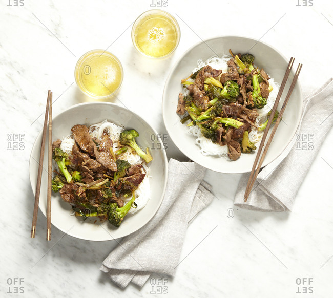 Beef and broccoli with noodles served with beer