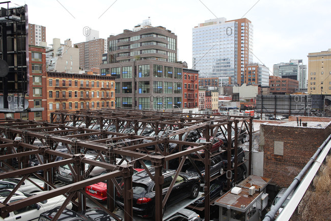 New York City, NY - January 17, 2013: Views from The High Line of stacked commuter car parking in Manhattan, New York