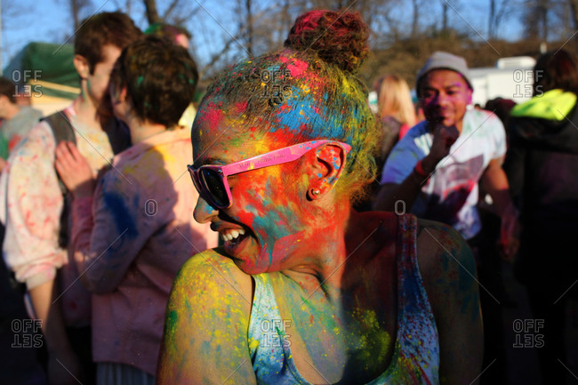 New York City, NY - April 6, 2013: Woman covered in colorful powder during the Festival of Colors Holi NYC event at the Cultural Performing Arts Center, Brooklyn, New York