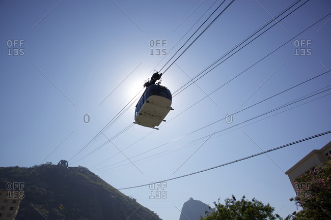 Rio de Janeiro, Brazil - August 27, 2010: Cable cars taking tourists and sightseers to and from the top of Sugar Loaf Mountain in Rio de Janeiro. Brazil