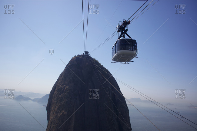 Rio de Janeiro, Brazil - August 27, 2010: Cable cars taking people to and from the top of Sugar Loaf Mountain in Rio de Janeiro. Brazil