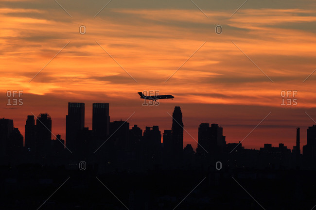 Viewed from Flushing, Queens, New York of the sun setting behind the Manhattan skyline