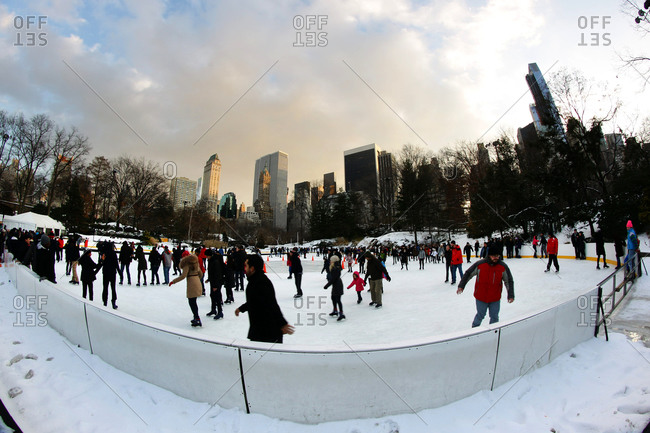 New York City, New York - December 18, 2013: People ice skating at the Wollman Ice Skating Rink, also know as The Trump Skating Rink at the southern part of Central Park, Manhattan, New York