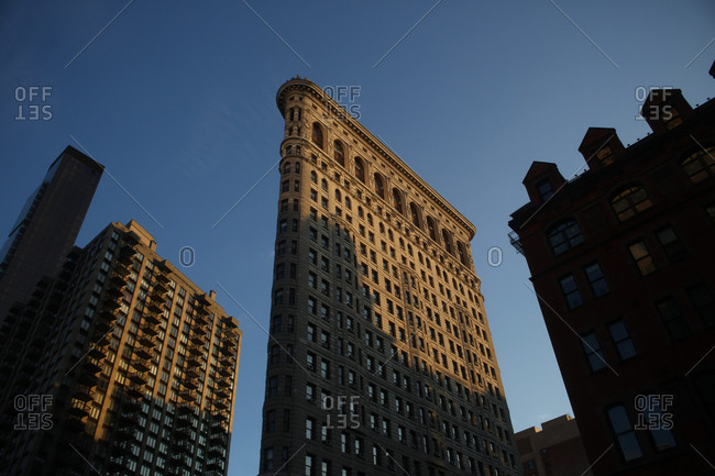 New York City, New York - November 25, 2012: The Flatiron Building in the late afternoon sunshine in Manhattan, New York