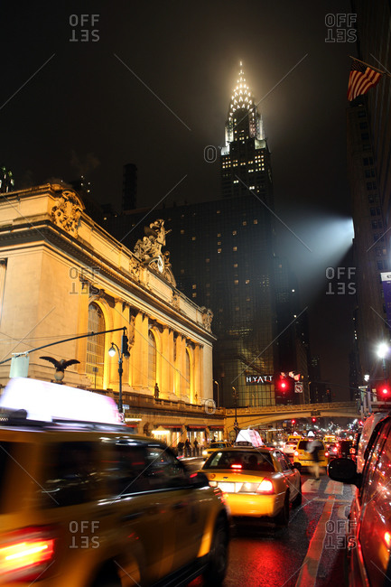 New York City, New York - January 30, 2013: An exterior night shot of Grand Central Terminal and the Chrysler Building in Manhattan, New York
