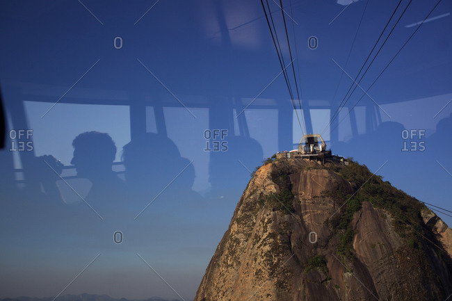 Rio de Janeiro, Brazil - August 24, 2010: Cable cars taking tourists and sightseers to and from the top of Sugar Loaf Mountain