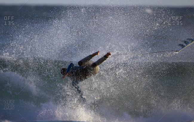 Surfer during a big swell at Arpoador Beach near Apoador Point