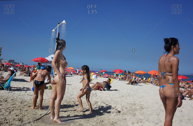 Rio de Janeiro, Brazil - July 31, 2010: Women showering on Ipanema beach
