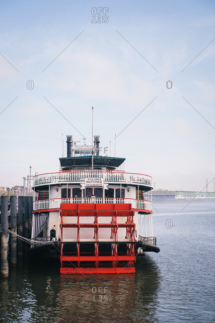 New Orleans, LA, USA - April 29, 2011: Old fashioned steamboat moored at a dock