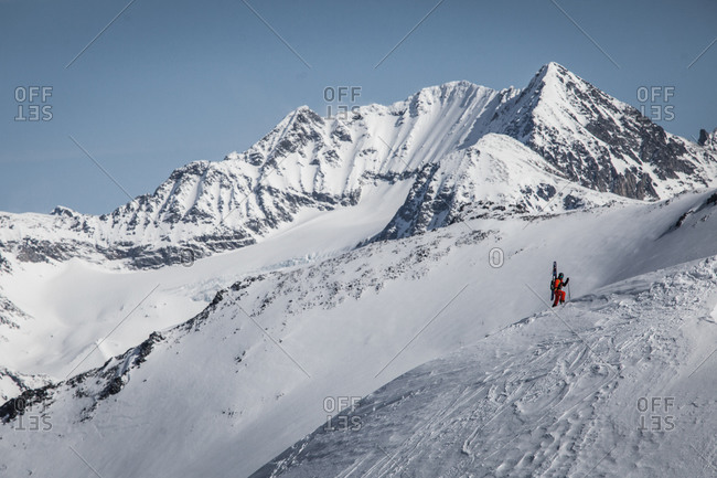 Climber moving uphill through the snow in the mountains