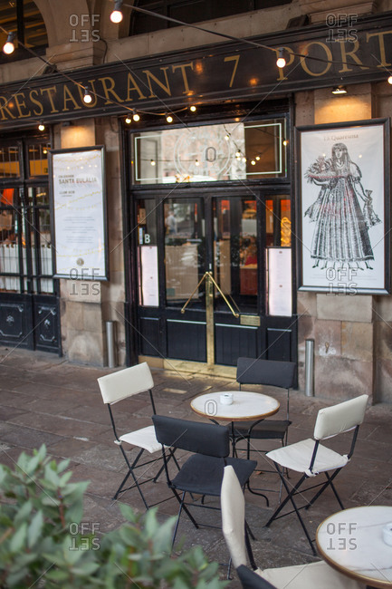 Barcelona, Spain - February 18, 2016: Empty tables and chairs outside of a cafe