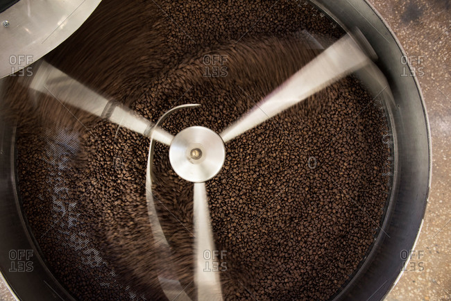 Coffee beans spinning in a roaster
