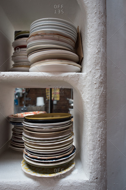 Stacks of plates on a shelf