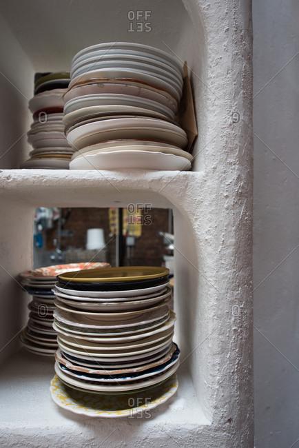 Stacks of plates on a shelf