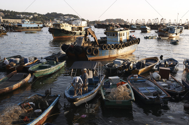 Hong Kong, China - July 23, 2011: Fishing boats moored at sunset by Lamma Island