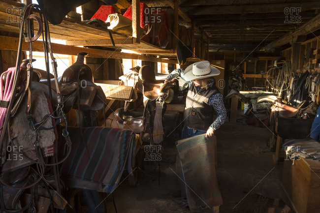 Cowgirl getting gear from storeroom