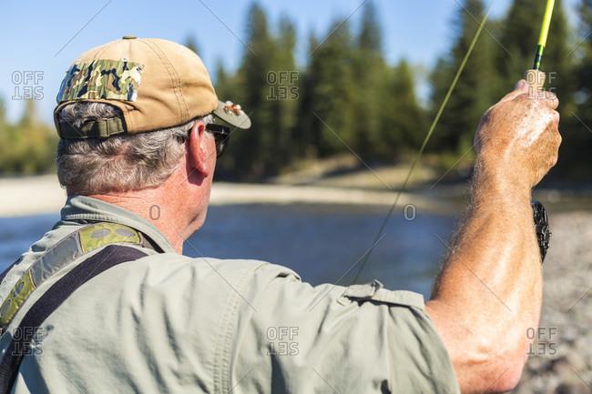 Fly fisherman casting, British Columbia