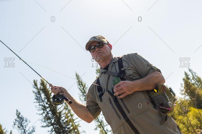 Fly fisherman casting reel