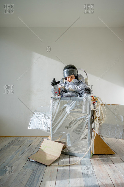 A boy pretending to be astronaut