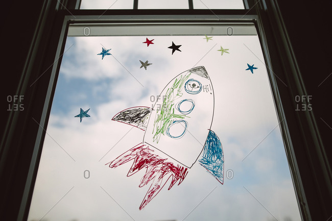 Rocket ship drawn on a window pane