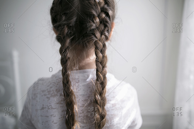 Close-up of a girl's braids from behind