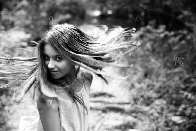 Girl twirling her hair